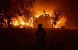 A home burns in Vacaville, California during the LNU Lightning Complex fire on August 19, 2020. - As of the late hours of August 18,2020 the Hennessey fire has merged with at least 7 fires and is now called the LNU Lightning Complex fires. Dozens of fires are burning out of control throughout Northern California as fire resources are spread thin. (Photo by JOSH EDELSON / AFP)