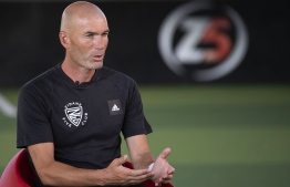 "French former football player and today Real Madrid's head coach Zinedine Zidane speaks to journalists during the presentation of a sports and educational program called ""Zidane Five Club"" (ZFC), in Aix-en-Provence, southern France, on August 19, 2020. (Photo by Christophe SIMON / AFP)"