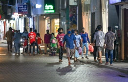 People seen walking across Majeedhee Magu in capital city Male' amid a vehicle ban introduced to curb the spread of COVID-19. PHOTO: AHMED AWSHAN ILYAS / MIHAARU