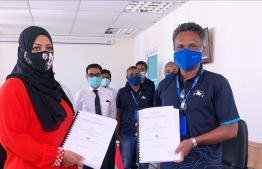 Transport Minister Nahula and MTCC CEO at the agreement signing ceremony for the project at Hoarafushi, Haa Alif Atoll. PHOTO: MTCC