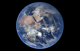 "(FILES)  This file NASA Earth Observatory photo released August 21, 2014 and acquired March 30, 2014 shows an image of Earth - Blue Marble from the time-lapse video of the VIIRS composite for the eastern hemisphere from January 18 to July 25, 2014. - Water covers 70 percent of the Earth's surface and is crucial to life as we know it, but how it got here has been a longstanding scientific debate. The puzzle was a step closer to resolution on August 27, 2020 after a team of French scientists reported in the journal Science they had identified which space rocks may have been responsible.Cosmochemist Laurette Piani, who led the research, told AFP that, contrary to prevailing theories, Earth's water may have already been contained in its building blocks. (Photo by HANDOUT / NASA / AFP) / RESTRICTED TO EDITORIAL USE - MANDATORY CREDIT ""AFP PHOTO /NASA/HANDOUT "" - NO MARKETING - NO ADVERTISING CAMPAIGNS - DISTRIBUTED AS A SERVICE TO CLIENTS / TO GO WITH AFP STORY BY ISSAM AHMED - ""Blue planet: Study proposes new origin theory for Earth's water"""