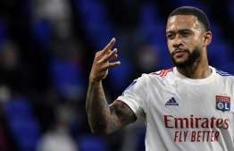 Lyon's Dutch forward Memphis Depay celebrates after scoring a goal during the French L1 footall match between Olympique Lyonnais (OL) and Dijon FC on August 28, 2020, at the Groupama Stadium in Decines-Charpieu, near Lyon, central-eastern France. (Photo by Philippe DESMAZES / AFP)