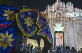 In this photograph taken on August 22, 2020, a decorated elephant stands in front of the Bellanwila Temple during the Esala Perahera festival in Colombo. - Esala Perahera festival, which usually draws thousands of spectators every year, took place with no spectator insight due to the restrictions amid COVID-19 coronavirus pandemic. (Photo by LAKRUWAN WANNIARACHCHI / AFP)