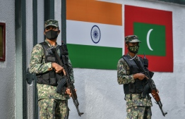 Officers of Maldives National Defence Force guarding the Indian High Commission. PHOTO: MIHAARU