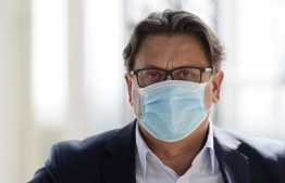 Chief Executive Officer of French pharmaceutical group Sanofi Paul Hudson wearing a face mask during a session of the employers' association Medef' s summer meeting at the Longchamp horse racetrack in Paris on August 27, 2020. (Photo by ERIC PIERMONT / AFP)