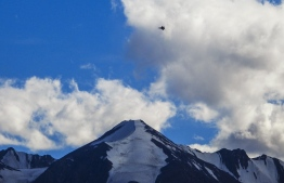 """An Indian fighter jet flies over a mountain range in Leh, the joint capital of the union territory of Ladakh, on August 31, 2020. - The Indian military on August 31 accused China of staging """"provocative"""" action on their contested Himalayan border where 20 Indian troops were killed in a battle in June. The Sino-Indian border conflict is an ongoing territorial dispute over the sovereignty of two relatively large, and several smaller, separated pieces of territory between China and India. The first of which, depicted here, is Aksai Chin, claimed by China as part of the Xinjiang Uygur Autonomous Region and Tibet Autonomous Region and claimed by India as part of the union territory of Ladakh; it is a virtually uninhabited high-altitude wasteland in the larger regions of Kashmir and Tibet and is crossed by the Xinjiang-Tibet Highway.  (Photo by Mohd Arhaan ARCHER / AFP)"""