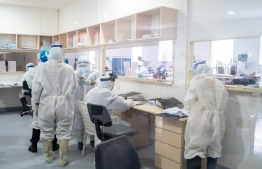 Health care workers wearing PPE operating inside a hospital. PHOTO: MIHAARU