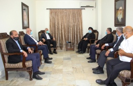 A handout picture released by the Hezbollah press office on September 6, 2020 shows Hassan Nasrallah (C-R), the head of Lebanon's militant Shiite movement Hezbollah, meeting with Hamas' political bureau chief Ismail Haniya (C-L) at an undisclosed location. (Photo by - / various sources / AFP)