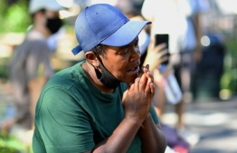 Lorri, 51, listens as musicians of the New York Philharmonic play with their 'bandwagon's pop-up concert series' at Betty Carter Park on September 04, 2020, in the Brooklyn Borough of New York City. - Its fall season has been cancelled and its concert hall closed indefinitely, so New York's Philharmonic is taking it to the streets. One of America's oldest musical institutions, the famed symphony orchestra is playing outdoor pop-up shows, getting creative during the coronavirus pandemic that has kept concert halls closed and New Yorkers starved for live music. (Photo by Angela Weiss / AFP)