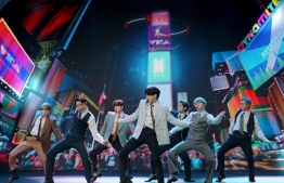 This handout image released courtesy of MTV shows South Korean boy band BTS performing from South Korea during the 2020 MTV Video Music Awards, being held virtually amid the coronavirus pandemic, broadcast on August 30, 2020 in New York. (Photo by - / MTV / AFP) /