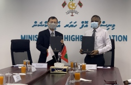 Higher Education Minister Ibrahim Hassan (R) and JICA Maldives' Resident Representative Mitsuyoshi Kawasaki signed the grant aid agreement for the project for Human Resource Development Scholarship (JDS) on September 10, 2020. PHOTO/JICA