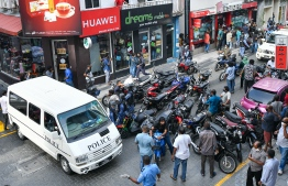 Maldives Police Service seen cordoning off a road in capital city male', disrupting and arresting multiple demonstrators during a motorcycle rally by opposition forces. PHOTO: AHMED AWSHAN ILYAS / MIHAARU