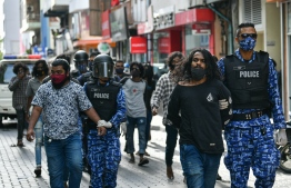 Maldives Police Service seen arresting multiple demonstrators during the opposition-led motorcycle rally in capital city Male'. PHOTO: AHMED AWSHAN ILYAS / MIHAARU
