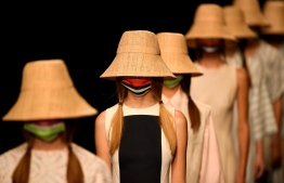 Models present outfits by Spanish designer Devota and Lomba's Spring/Summer 2021 collection during the Mercedes Benz Fashion Week in Madrid on September 10, 2020. (Photo by PIERRE-PHILIPPE MARCOU / AFP)