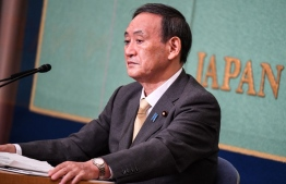 Japan's new Prime Minister Yoshihide Suga, then-Chief Cabinet Secretary, Yoshihide Suga attends a debate ahead of the Liberal Democratic Party's (LDP) leadership election, in Tokyo on September 12, 2020. (Photo by Charly TRIBALLEAU and CHARLY TRIBALLEAU / POOL / AFP)