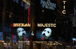 "(FILES) In this file photo taken on March 12, 2020 Signage of the Broadway play ""The Phantom of the Opera"" seen at Time Square in New York City. - Broadway stars who once lit up New York's most bankable stages are now facing a reckoning over the state of their art, in an industry that's bled money since the pandemic began. Like essentially all other cultural institutions, the city's famed musical theater district shut down as New York became the epicenter of Covid-19's grip on the United States in the spring. (Photo by Angela Weiss / AFP)"