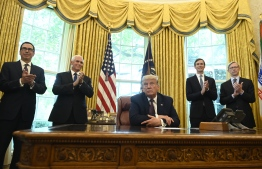 "US President Donald Trump is joined by (L-R) US Secretary of the Treasury Steven Mnuchin, US Vice President Mike Pence, Senior Advisor to the President Jared Kushner and US special representative for Iran, Brian Hook, in the Oval Office of the White House in Washington, DC, on September 11, 2020. - Trump announced Friday a ""peace deal"" between Israel and Bahrain, which becomes the second Arab country to settle with its former foe in the last few weeks. (Photo by ANDREW CABALLERO-REYNOLDS / AFP)"