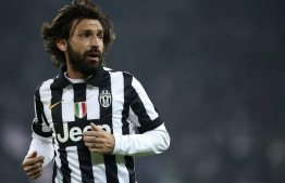"(FILES) In this file photo taken on January 6, 2015 Juventus' midfielder Andrea Pirlo runs on the pitch during the Italian Serie A football match Juventus vs Inter Milan at Juventus  Stadium in Turin. - Of course, football player Andrea Pirlo was a genius with the ball. But what about the coach? The ""Maestro"" starts off on the Juventus bench with a lot of pressure: not to be the one to interrupt a streak of nine consecutive Italian league titles. (Photo by Marco BERTORELLO / AFP)"