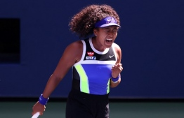 "(FILES) In this file photo taken on September 4, 2020 Naomi Osaka of Japan celebrates a point during her Women's Singles third round match against Marta Kostyuk of the Ukraine on Day Five of the 2020 US Open at USTA Billie Jean King National Tennis Center in the Queens borough of New York City. - Naomi Osaka, who captured her third Grand Slam title at the US Open on September 12, pulled out of the upcoming French Open with a hamstring injury on September 17.  ""Unfortunately I won't be able to play the French Open this year,"" Osaka said in posts on Instagram and Twitter. ""My hamstring is still sore so I won't have enough time to prepare for the clay - these two tournaments came too close to each other for me this year."" (Photo by AL BELLO / GETTY IMAGES NORTH AMERICA / AFP)"