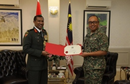 Maldives National Defence Force (MNDF)'s  Colonel Rauf accepting his Defence Advisor appointment. PHOTO: MIHAARU FILES