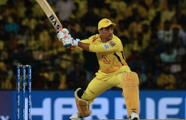 (FILES) In this file photo taken on May 7, 2019, Chennai Super Kings cricket captain Mahendra Singh Dhoni plays a shot during the 2019 Indian Premier League (IPL) first qualifier Twenty20 cricket match between Chennai Super Kings and Mumbai Indians at the M.A. Chidambaram Stadium in Chennai. - Dhoni may have signed off from international duties but he'll be at the heart of the action in the Indian Premier League -- a tournament he helped inspire, and where he remains a towering figure. (Photo by ARUN SANKAR / AFP)