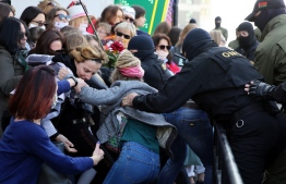 Law enforcement officers scuffel with women during a rally to protest against the Belarus presidential election results in Minsk on September 19, 2020. - Belarus President Alexander Lukashenko, who has ruled the ex-Soviet state for 26 years, claimed to have defeated opposition leader Svetlana Tikhanovskaya with 80 percent of the vote in the August 9, elections. PHOTO: TUT.BY / AFP