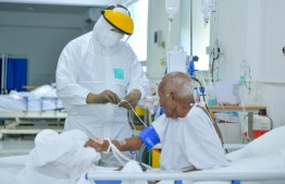 A nurse attending a COVID positive patient at the Hulhumale Medical facility. PHOTO: NISHAN ALI / MIHAARU