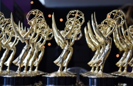 "(FILES) In this file photo taken on September 17, 2018, Emmy statues are seen before the 70th Emmy Awards at the Microsoft Theatre in Los Angeles, California. - No red carpet, no star-studded audience and no ""Game of Thrones"" -- this year's Emmys honoring the best in television promise to be radically different as producers scramble to create Hollywood's first major pandemic-era award show. The coronavirus has turned Tinseltown upside-down, bringing productions to a halt even as lockdown orders around the world send binge-watching through the roof. (Photo by Valerie MACON / AFP)"