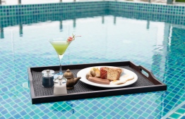 Wind down with a floating breakfast at AZUVIA Beach Retreat's rooftop infinity pool. PHOTO/SIMDI