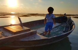 A young child pictured in a small boat docked at Thulhaadhoo, Baa Atoll. PHOTO: NASHEETH THOHA / UN MALDIVES