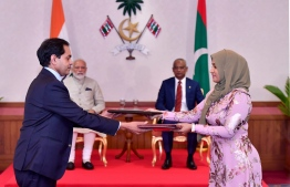 Indian High Commissioner Sunjay Sudhir (L) and Transport Minister Aishath Nahula: the memorandum of understanding to establish the cargo ferry service between Maldives and India was signed during Indian Prime Minister Narendra Modi's visit to Maldives last year.  PHOTO: HIGH COMMISSION OF INDIA.