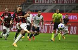 AC Milan's Swedish forward Zlatan Ibrahimovic scores on a penalty kick during the Italian Serie A football match AC Milan vs Bologne at the San Siro stadium in Milan on September 21, 2020. (Photo by MIGUEL MEDINA / AFP)