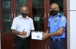 Ref Cool donates 1000 face masks and 360 bottles of May Care brand hand sanitiser to Maldives Police Service. PHOTO: POLICE