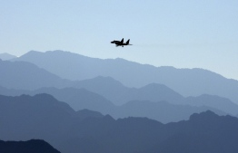 An Indian Air Force fighter jet flies over a mountain range in Leh, the joint capital of the union territory of Ladakh bordering China, on September 15, 2020. (Photo by Mohd Arhaan ARCHER / AFP)