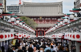 People visit Sensoji temple in Tokyo's Asakusa district on September 22, 2020. (Photo by Charly TRIBALLEAU / AFP)