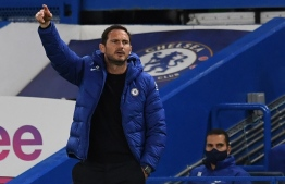 Chelsea's English head coach Frank Lampard gestures  during the English League Cup third round football match between Chelsea and Barnsley at Stamford Bridge in London on September 23, 2020. PHOTO: NEIL HALL / POOL / AFP