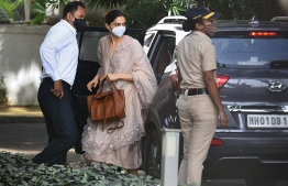 Bollywood actress Deepika Padukone (C) arrives to attend questioning by Narcotics Control Bureau (NCB) officials, in Mumbai on September 26, 2020. - Padukone was questioned on September 26 by Indian authorities in connection with a drugs probe into the suicide of actor Sushant Singh Rajput. (Photo by Samit Jadhav / AFP)
