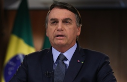 This handout picture released on September 22, 2020 by Brazilian Presidency shows Brazil's President Jair Bolsonaro recording a speech for the 75th General Assembly of the United Nations Council in Brasilia, on September 16, 2020. (Photo by Handout / Brazilian Presidency / AFP) /