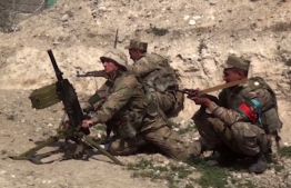 """An image grab taken from a video made available on the official web site of the Azerbaijani Defence Ministry on September 28, 2020, allegedly shows Azeri troops conducting a combat operation during clashes between Armenian separatists and Azerbaijan in the breakaway region of Nagorno-Karabakh. (Photo by Handout / Azerbaijani Defence Ministry / AFP) / RESTRICTED TO EDITORIAL USE - MANDATORY CREDIT """"AFP PHOTO / Azerbaijani Defence Ministry"""" - NO MARKETING NO ADVERTISING CAMPAIGNS - DISTRIBUTED AS A SERVICE TO CLIENTS --- NO ARCHIVE ---"""
