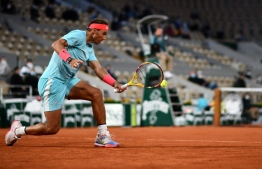 Spain's Rafael Nadal returns the ball to Belarus' Egor Gerasimov during their men's singles first round tennis match at the Philippe Chatrier court on Day 2 of The Roland Garros 2020 French Open tennis tournament in Paris on September 28, 2020. (Photo by Martin BUREAU / AFP)