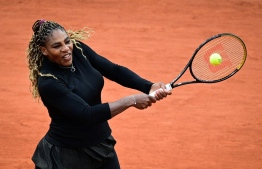 Serena Williams of the US returns the ball to Kristie Ahn of the US during their women's singles first round tennis match at the Philippe Chatrier court on Day 2 of The Roland Garros 2020 French Open tennis tournament in Paris on September 28, 2020. (Photo by MARTIN BUREAU / AFP)