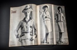 """This picture shows a magazine with creations by French designer Gabrielle Chanel displayed during the exhibition """"Gabrielle Chanel, fashion manifesto"""" at the Galliera Palais fashion museum in Paris on September 25, 2020. - The exhibition runs from October 1, 2020 to March 14, 2021. (Photo by STEPHANE DE SAKUTIN / AFP)"""