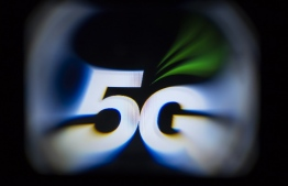 (FILES) This file illustration picture taken on February 18, 2019  shows the 5G wireless technology logo displayed on a tablet in Paris. - France launches auction for remaining controversial 5G frequencies, AFP reports. (Photo by Lionel BONAVENTURE / AFP)