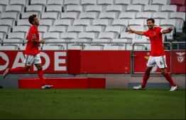 Benfica's Portuguese defender Ruben Dias (R) celebrates with Benfica's German forward Luca Waldschmidt after scoring during the Portuguese league football match SL Benfica against Moreirense FC at the Luz stadium in Lisbon on September 26, 2020. (Photo by CARLOS COSTA / AFP)