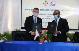 Resident Representative for JICA Maldives Mitsuyoshi Kawasaki and Minister of Finance Ibrahim Ameer at the ceremony held to sign the SD 47.5 million (JPY 5 billion) loan agreement extended by Japan. PHOTO: JICA