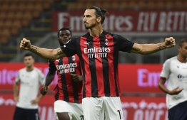 (FILES) In this file photograph taken on September 21, 2020, AC Milan's Swedish forward Zlatan Ibrahimovic celebrates after scoring his team's second goal on a penalty kick during the Italian Serie A football match AC Milan vs Bologne at The San Siro stadium in Milan. (Photo by MIGUEL MEDINA / AFP)