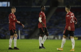 Manchester United's French midfielder Paul Pogba (C) reacts at the final whistle during the English  League Cup fourth round football match between Brighton and Hove Albion and Manchester United at the American Express Community Stadium in Brighton, southern England on September 30, 2020. (Photo by Matt Dunham / POOL / AFP