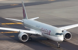 A Qatar Airways flight on a runway. The airline expanded its number of destinations to 100. PHOTO: QATAR AIRWAYS