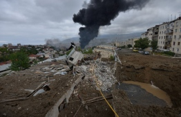 A view shows aftermath of recent shelling during the ongoing fighting between Armenia and Azerbaijan over the breakaway Nagorno-Karabakh region, in the disputed region's main city of Stepanakert on October 4, 2020. (Photo by Karo Sahakyan / Armenian Government / AFP)