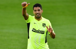 Atletico Madrid's Uruguayan forward Luis Suarez gestures during the Spanish league football match SD Huesca against Club Atletico de Madrid at the El Alcoraz stadium in Huesca on September 30, 2020. (Photo by Pau BARRENA / AFP)